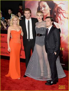 Elizabeth Banks, Liam Hemsworth, Jennifer Lawrence, and Josh Hutcherson at the premiere of The Hunger Games: Catching Fire at the Nokia Theatre in Los Angeles, CA on 11/18/13.