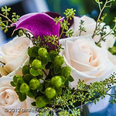 Bright and colourful bridal bouquet. Pale pink roses and purple cala lilies. Bridal bouquet, wedding flowers.