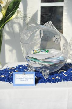 """Be creative with your """"card box"""". This is a glass fish card holder at a nautical themed wedding."""