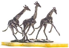 Artwork by Tienie Pritchard, Three Giraffes, Made of bronze on a marble base