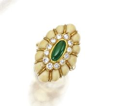 GOLD, DIAMOND, JADE AND CONCH SHELL RING, VAN CLEEF & ARPELS.  The ring set with a cabochon jade segment, framed by round diamonds weighing approximately 1.50 carats, within a carved conch shell frame, size 9¼, signed Van Cleef & Arpels, NY, numbered 43836