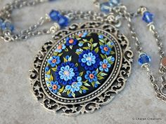 Items similar to Gorgeous Polymer Clay Applique Statement Pendant Necklace in Yellows and Blue on Etsy