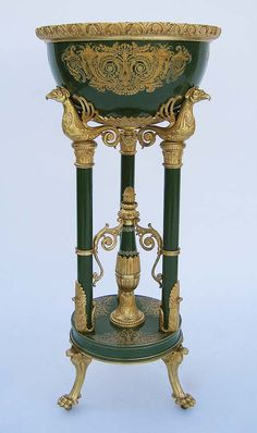 A Very Fine and Rare French 19th Century Napoleon III Gilt-Bronze Mounted Porcelain and Enamel Jardinière, probably by Sèvres, the circular basin with cast foliate rim and decorated with cornucopia within foliate scroll ornament, supported on turned columns headed by mythical birds united by a center standard, on circular plinth and outswept feet ending in talons. Circa: 1870