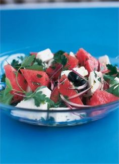 Watermelon, Feta And Black Olive Salad With Purple Onion, Lime, Watermelon, Feta Cheese, Parsley, Fresh Mint, Extra-virgin Olive Oil, Pitted Black Olives, Black Pepper