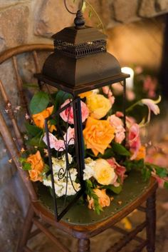 I'm not a fan of this lantern or of the flowers for that matter, but I actually do like the idea of putting flowers inside the lanterns as part of the centerpieces. Maybe you could do some with candles and some with flowers.