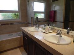 The master bath must have double sinks. Here's a typical standard dual sink arrangement. Our houses in Texas had something very similar to this.