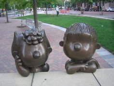 This bronze statue of Charles Schultz's Peanuts characters Charlie Brown and snoopy was created in 2003 by Tivoli Too, a sculpting and design studio. Cartoon Creator, Folded Book Art, Book Folding, Book Sculpture, Paper Sculptures, Peanuts Characters, Art Sites, Art Lessons Elementary, Peanuts Snoopy