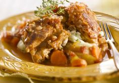 """Sebzeli İncik Lamb Shanks with Vegetables  Ingredients:  4 200 gr pieces of shank meat 3 """"sivri"""" peppers 4 cloves garlic 3 T oil 2 carrots, cubed 2 celeriac roots, peeled and cubed 2 zucchinis, cubed ½ kg pearl onions, peeled ½ kg tomatoes, peeled and cubed. Salt, black pepper to taste"""