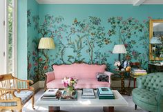 Perennial Blooms - The couple's London living room, which features a custom botanical mural scene by Zuber and a marble coffee table of their own design.