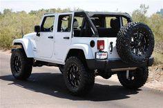 white 4 door soft top Jeep Rubicon sport