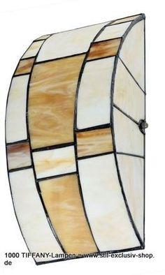 Designer TIFFANY-Decken-/ oder Wand-Lampe, unsere Serie ROUNDABOUT.                      universell einsetzbar ! 33cm breit, 15cm hoch + breit. 2 x E-14, je E-40W   Perfekt für niedrige Decken !  Diese halbrunde Tiffany-Wandlampe / Deckenlampe erzeugt durch den geschlossenen Lampenschirm einen verblüffenden und stimmungsvollen Effekt. Die Farben des Glases sind warmes Orange und Gelb.    Die Lampe kann sowohl horizontal, vertikal oder auch an der Decke angebracht werden.