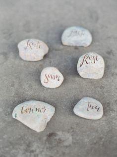 DIY rock place cards: http://www.stylemepretty.com/little-black-book-blog/2014/11/20/urban-zen-wedding-inspiration/ | Photography: Joshua Aull - http://www.joshuaaull.com/
