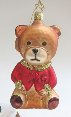 "Give your child a new Christmas ornament each year.  The Christmas Teddy - Teddy Bear - glass ornament from Inge-Glas of Germany is such perfection. –Mouth-blown and Hand-painted. 5-1/2"""" from tip of cap to bottom of ornament.  With Inge-Glas acid free paper and a gift box. Inge-Glas of Germany - since 1596 - Oldest Christmas Ornament Company in the World. For Christmas Teddy and other delightful ornaments for our child's Christmas shop > www.mygrowingtraditions.com"