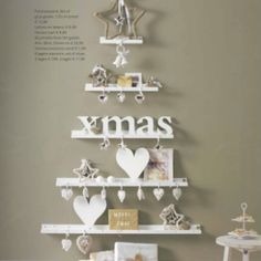 Decorated for Christmas on shelves that look similar to the shape of the tree!