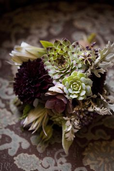 """Bouquet by The Cutting Garden.. Incorporating """"Hens and chicks""""(the succulent green w/burgundy tips and the small green)looks great...Just wondering what you do for a stem. They grow tight to the ground."""