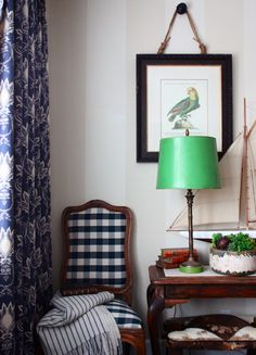 A pop of emerald green in this table lamp adds modern zing to this pattern-heavy corner. Source