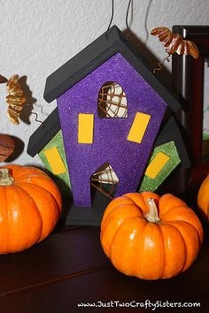 DIY Halloween House for indoor Halloween decor. Buy a wood house on after season sale and paint it for a cute haunted Halloween house. Halloween Haunted Houses, Halloween House, Halloween Pumpkins, Halloween Diy, Diy Halloween Decorations, House In The Woods, Indoor, Seasons, Crafty