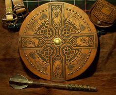 This Scottish Targe was constructed based on the Tandy Leather pattern. The shield boss (brass center) is hand hammered. |  Made by Mike Pruette at CelticLeatherworks.com.
