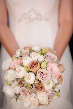 Creme de menthe, Julia and ivory David austins, teamed with dusty miller foliage and soft pink lisianthus