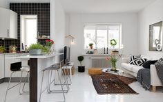Combing living room, dining table and kitchen together. Small space living. Wish my apartment was configured like this!