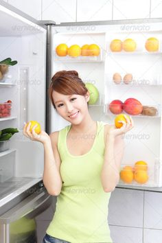 Healthy Eating Concept ...  adult, apple, asian, attractive, beauty, bite, body, breakfast, care, cheerful, chinese, cucumber, dieting, door, eat, food, fresh, fridge, fruit, girl, green, grocery, happy, health, healthy eating, home, hungry, icebox, japanese, kitchen, kiwi, laughing, lifestyle, loose weight, model, nutrition, orange, person, red, refrigerator, salad, slim, smile, think, tomato, vegetable, weight loss, woman, yellow, young