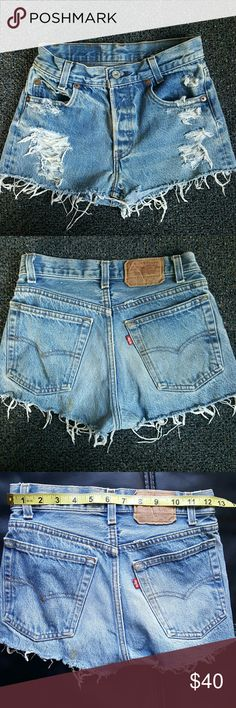 "Vintage Distressed 501 Button fly Jean Shorts Plzzzz make sure your waist is 25"" or smaller or it won't fit you. They are small and do not stretch ,shorts are vintage. First 4 pics are of actual shorts for this listing.  My daughter is modeling hers in size 26.  Waist measured flat 12.5"" , total all around waist 25"" as seen in pic . Price firm Levi's  Shorts Jean Shorts"