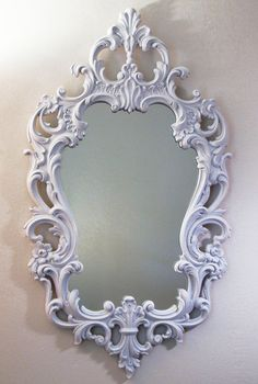 This is a lot like the mirror that I had in my room in Putney except it was off white with gold trim to match the French provincial dresser. I still have it in the attic.