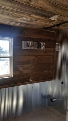 Beginning stages of transforming an old bathroom to a rustic laundry room. We restored 100 year old barn wood.