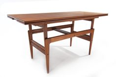 Danish Mid-Century teak elevator table by Kai Kristiansen. Converts from a coffee to a dinning or work table! $1795.00
