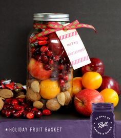 Make this fruit basket in a jar for those on your gift giving list this holiday season! This is a great traditional Christmas gift with a modern spin. It is in a very large jar from Ball that works perfectly for this gift in a jar idea! #madefromhere