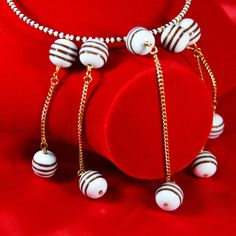You'll have a ball with this jewelry set. Actually, you'll have a dozen. This avant garde jewelry set, which includes a choker and earrings, will bring bold attention to a stunning decolletage. Wear it as art, or give it to an art-loving friend. $25. Buy now at #SmallestPlanet.
