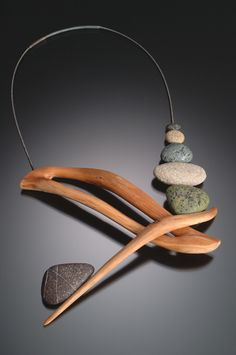 Wearable art by Kathleen Dustin. Zen Intersection necklace using mountain laurel wood, polymer and steel cable.