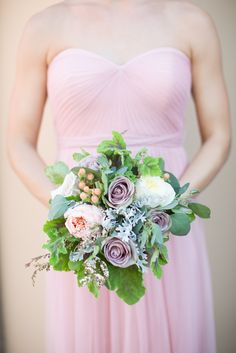 Bridesmaid bouquet with purple roses?! Yes please! View the full wedding here: http://thedailywedding.com/2015/11/20/romantic-floral-wedding-rachel-perry/