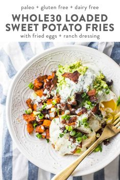 These Whole30 loaded sweet potato fries will surprise you with just how delicious they are. Filling enough for a Whole30 dinner, this recipe is also an excellent Whole30 side dish. With bacon, fried eggs, guacamole, green onions, and garlicky ranch dressing, you'll never feel like you're depriving yourself on a Whole30 with this recipe in your arsenal. #whole30 #paleo #glutenfree #dairyfree
