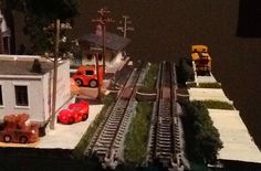 Single module with Tow Mater and Lightning McQueen Squinkies and scratchbuilt telephone poles.
