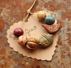 Gaea handmade ceramic design elements and adornments! | gaea Ceramic acorn and bird bead set.