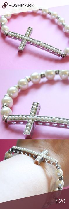 Beautiful Bride Pearl Cross Bracelet Elegant Glam Elegant beaded bracelet with ornate pearl cross at the center. Bracelet is made with glass pearls, and has silver beads in between each. At the center is a silver cross with pearls embedded in the center, and has heart cutouts on the sides. Perfect gift for a bride, religious event, or just that special gift. Bracelet stretches to for any wrist. Boutique Jewelry Bracelets