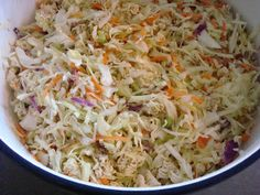 Chinese Cole Slaw  For dressing:  1/3 cup white vinegar  1 cup vegetable oil  1/2 cup of sugar  3 seasoning packets from chicken flavored ramen noodles    Mix the dressing ingredients and let marinate overnight.    Combine the dressing with these remaining ingredients:  1 cup glazed pecans (optional)  1 cup sunflower seeds  2 bads of cole slaw mix  10 - 12 green oinions  3 bags of ramen noodles