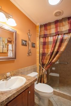 Traditional 3/4 Bathroom with Raised panel, limestone tile floors, Limestone Tile, Complex granite counters, Crown molding