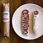 An absurd amount of cumin, orange zest and garlic make this Olympic Provisions most flavorful and unique salami. Order Loukanika Salami by Olympic Provisions!