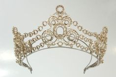 Working model in silver of the tiara gifted to Queen Emma of the Netherlands by her husband, King William III, just before he died.  Tiara made by Mellerio around 1890 (?).  She was photographed wearing this silver model in 1891.