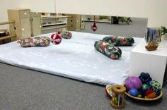 From the time the infant is two to three weeks old (until crawling/walking) he or she should have an area for movement. This includes a movement mat, mirror and low shelf.
