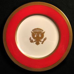 President Ronald Reagan, 40th President of the United States (1981–1989) and First Lady Nancy Reagan chose a scarlet red color for their State Dinner Service. The gorgeous Presidential Arms, in the center of the plates, was hand-applied in raised gold paste. Forty separate handlings and an unheard of nine firings were required to make this Official White House Service for 220 at a cost of 210,399.00 dollars.