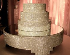 This 20 square cake stand is covered in over 13,000, high quality, point backed crystals. Standing approximately 5 1/2 tall with removable mirror on top, for easy cleaning and transport. It is a real stunner and will make any cake look gorgeous and grand. If you are a professional baker or decorator this is a great rental item to offer your customers.