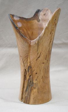Lathe-turned oak vase by Anne Birkholz...more art to see on the Studio Tour on March 23-24-25 in Three Rivers.