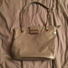 Ivanka Trump pocketbook Gorgeous Silverish-gray with silver chains pocketbook.  Magnet and zipper enclosure with 3 inside pockets and a zippered inside pocket. No wrips or tears.  Great bag for a night out on the town!!!  Re-Poshing. Ivanka Trump Bags Shoulder Bags