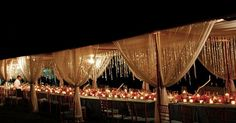 Tall table setting with draping canopy and lights