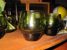 Bar & Serving Ware  Subscribe to our feed. rss feed icon    Vintage mid century modern set of 7 olive green liqueur glasses and 3 olive dishes. - $35  This lot of seven nice quality mid century olive green liqueur glasses and three matching olive condiment dishes is in fantastic condition with no chips, cracks or scratches.  With great color and great lines this sweet set is just perfect for that next cocktail party get together.