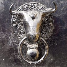 Metal bull's head door knocker.  I'd think twice about wanting to knock it, lol.