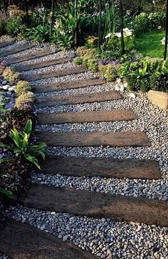 Garden pathway made from discarded railway crossties and gravel